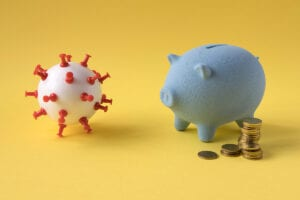 Financial difficulties due to Covid-19. Piggy bank running out of money due to coronavirus.