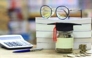 college savings jar and calculator