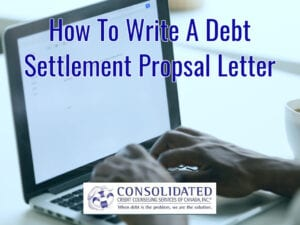 Person typing a debt settlement proposal letter
