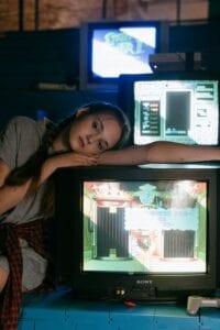 Girl leaning on tv